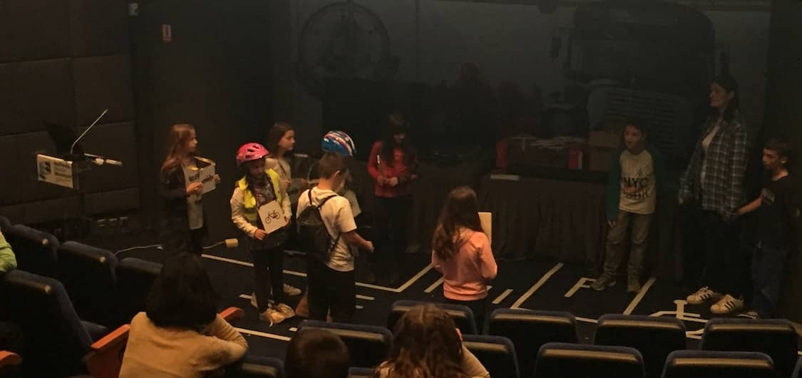 Children act out safe road crossing