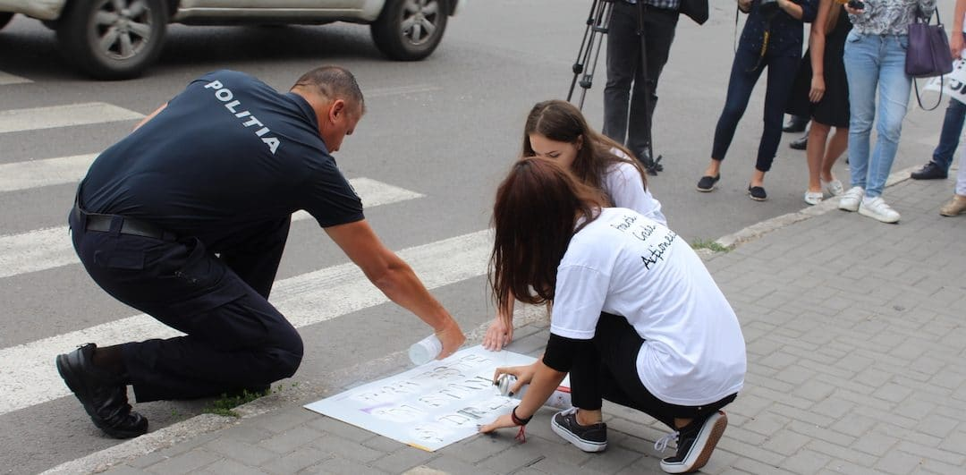 ACM paint roadside reminders for pedestrians to take care